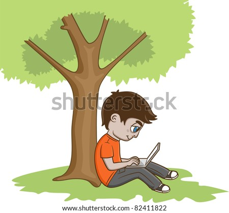 Young Man Sitting under the tree and using laptop